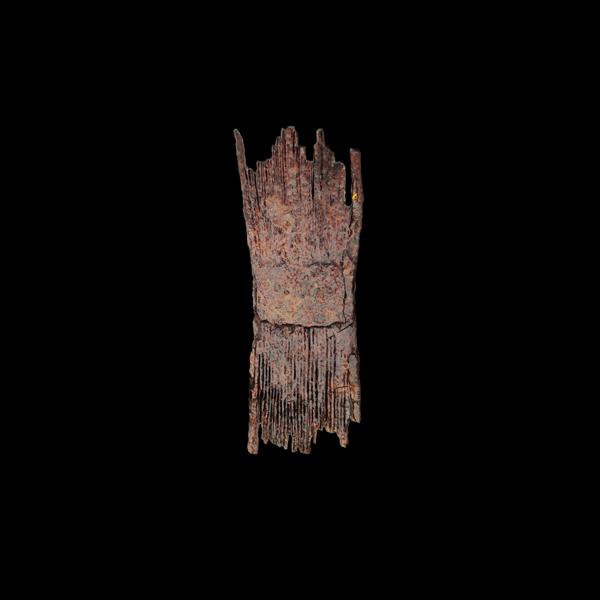 Placa de ferro en forma de peite ou ripo.
